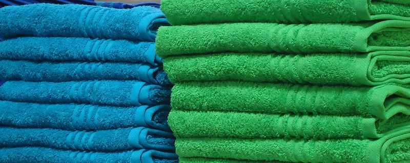 Blue_and_green_towels_on_a_shelf_in_a_store_in_New_Jersey