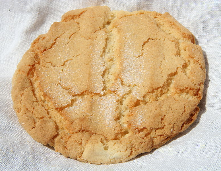 Plain sugar cookie on a white linen cloth